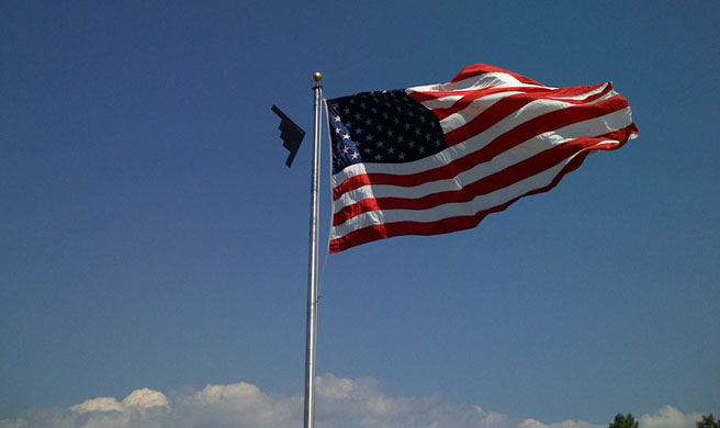 B-2 Spirit Bomber flying past old glory